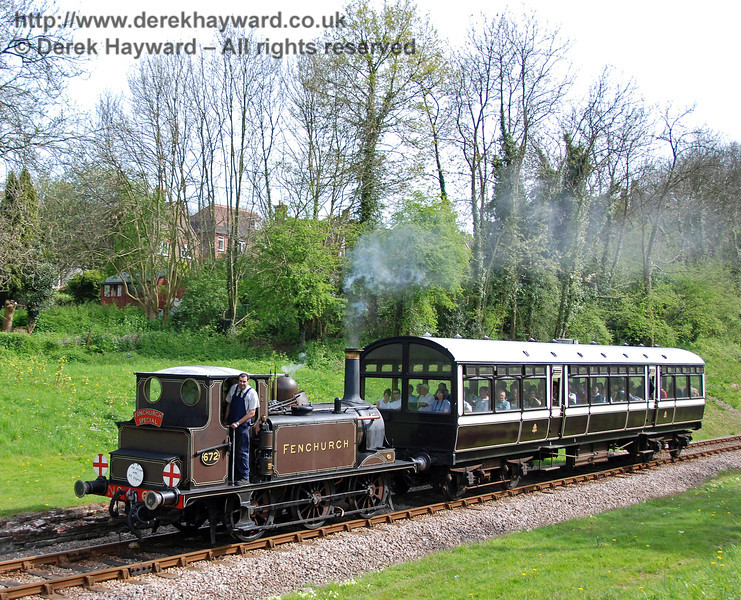 672 Fenchurch passes through the site of the former West Hoathly station with the Observation Car.  23.04.2009  0116