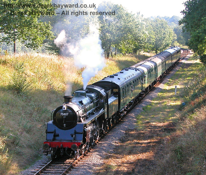 75027 approaches Horsted House Bridge as the evening shadows lengthen. 29.08.2005