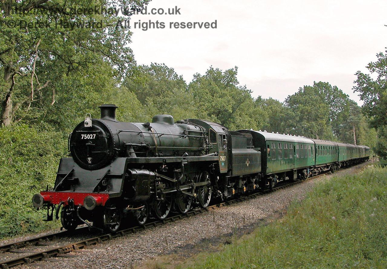 75027 steams north past Birch Farm Crossing. 29.07.2006