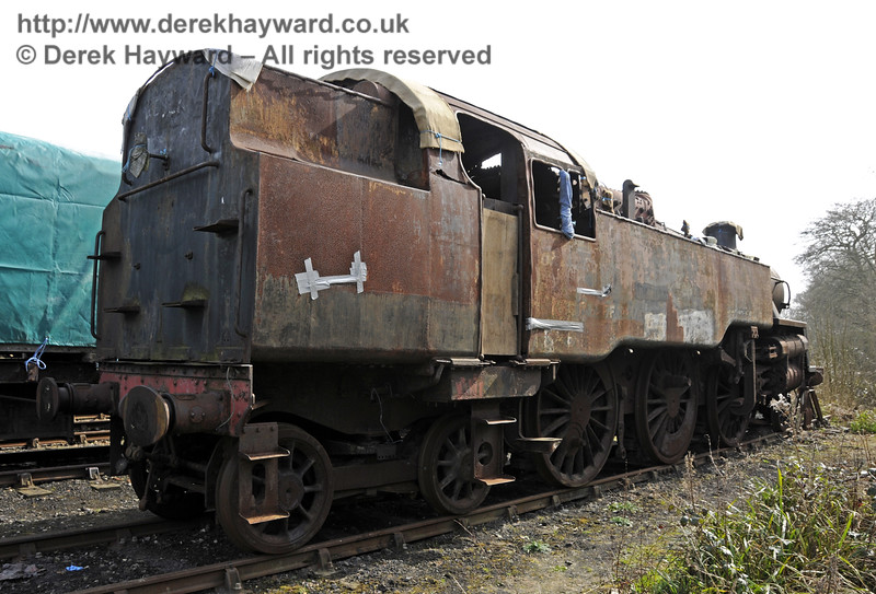 In 2015 80100 was moved to a siding at Horsted Keynes which is out of public view.  After this picture was taken the locomotive was again covered with a tarpaulin. 10.04.2015  12164