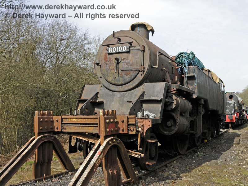 In 2015 80100 was moved to a siding at Horsted Keynes which is out of public view.  After this picture was taken the locomotive was again covered with a tarpaulin.  10.04.2015  12162