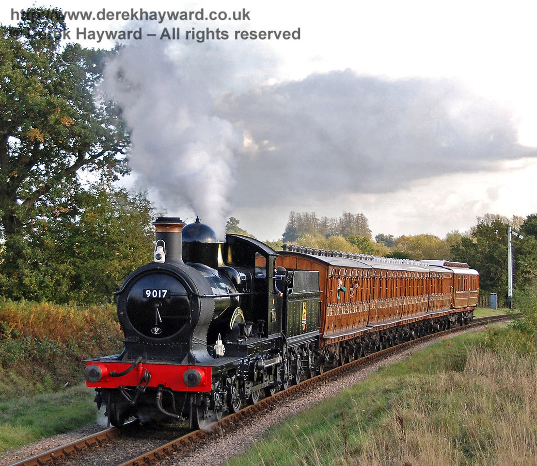 9017 Earl of Berkeley steams north from Sheffield Park with the Victorian coaches and the Director's Saloon. 10.10.2009  0130