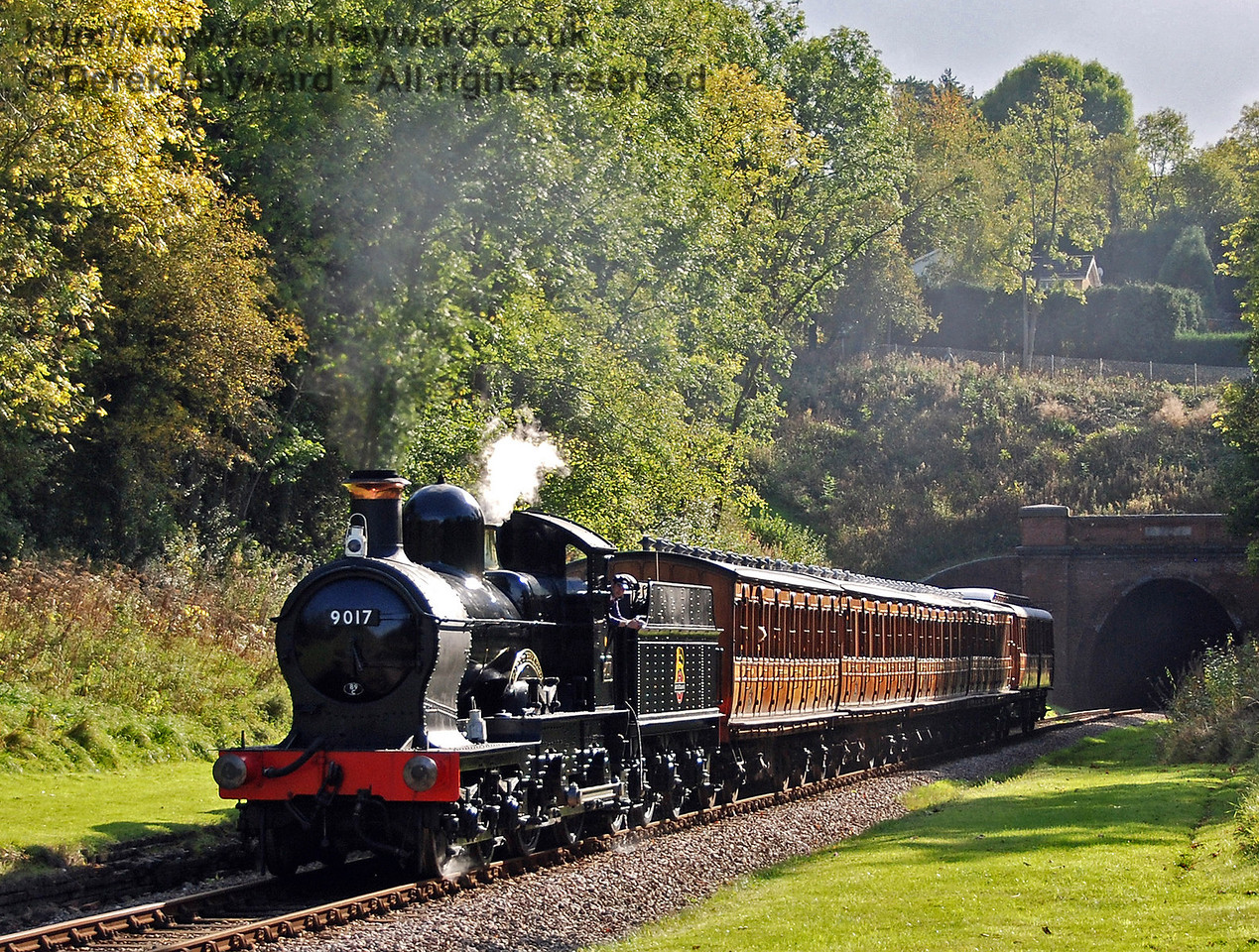 9017 Earl of Berkeley emerges from West Hoathly tunnel with the Victorian coaches. 10.10.2009  0094