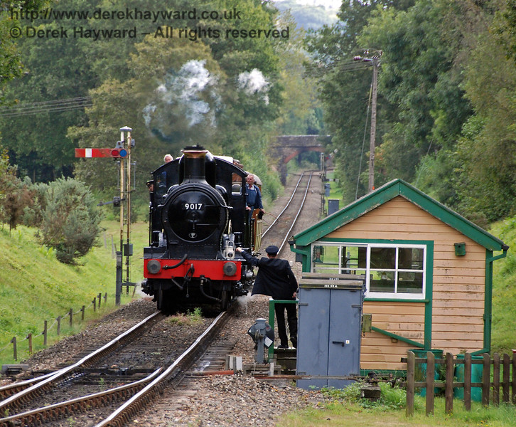 Heads look out from every angle as 9017  Earl of Berkeley approaches Kingscote south signal box. 13.09.2009  0005