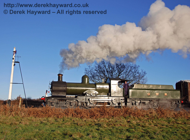 On a bright but cold December day 9017 Earl of Berkeley steams north past the Sheffield Park Advance Starter. 07.12.2008