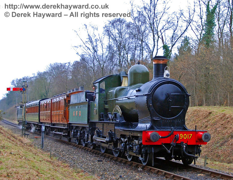 9017 Earl of Berkeley arrives at Kingscote with a train of mixed stock including the four wheelers. 23.02.2008