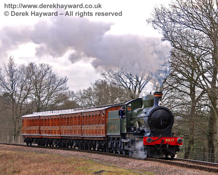 9017 Earl of Berkeley rounds the curve south of Horsted House Farm with the Victorian coaches. 22.02.2009