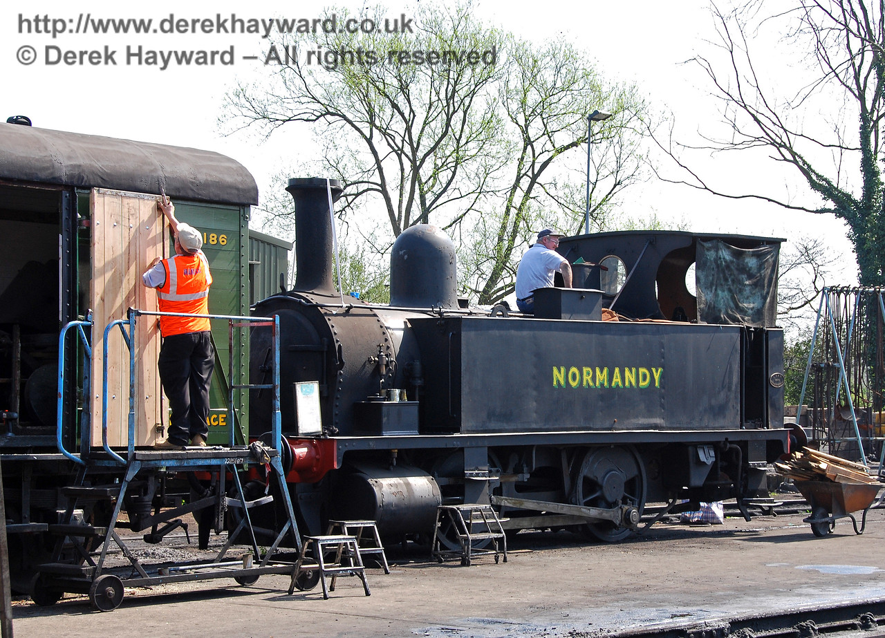 Normandy receives some care and attention outside Sheffield Park shed, as van 2186 gets new doors. 15.04.2007