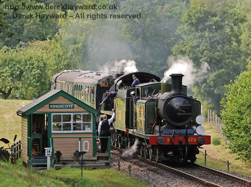 B473 and 1638 receive the single line token as they pass the Kingscote south signal box.  07.08.2010  30018