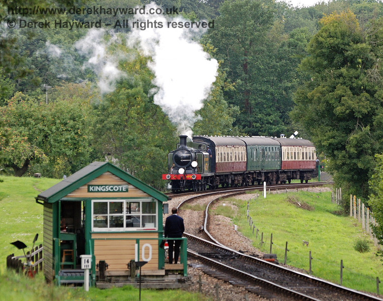 The signalman waits as B473 leaves Kingscote with the Wealden Rambler.  04.09.2010  30059