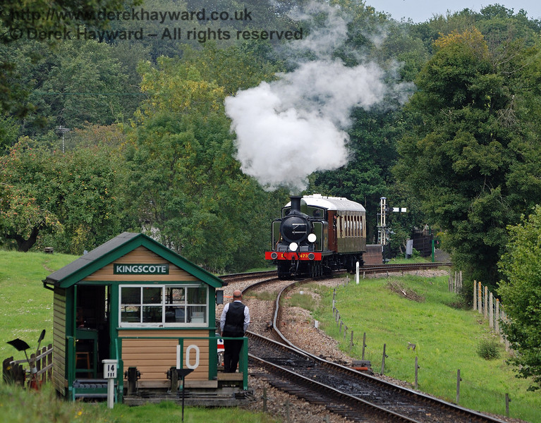 The signalman stands ready with the token as B473 leaves Kingscote with the Pullman motor coach from EMU 3051, during a private charter.  05.09.2010  30026