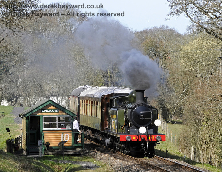 B473 steams south from Kingscote signal box.  25.03.2012  7720