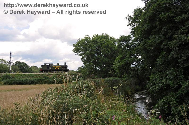 The River Ouse meanders along as B473 shunts outside Sheffield Park.  28.07.2010  3527