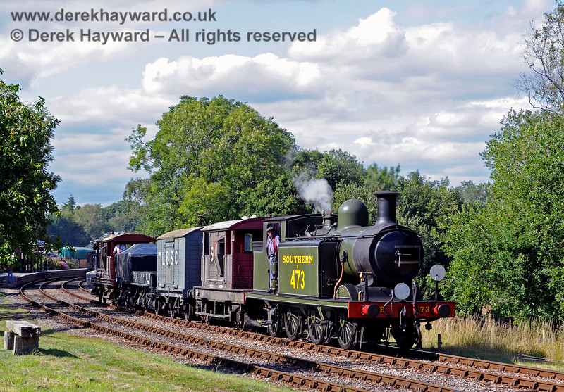 B473 departs south from Kingscote with a goods train. 01.08.2015 11778