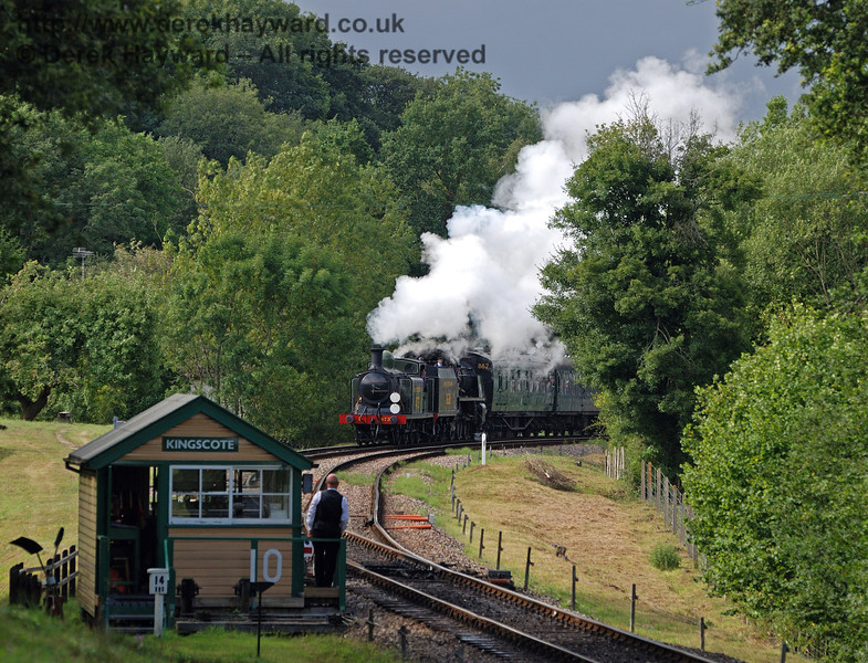 The signalman watches as B473 and 1638 leave Kingscote.  07.08.2010  30015