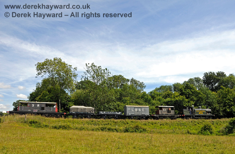 B473 steams towards Three Arch Bridge with a goods train. 01.08.2015 13384