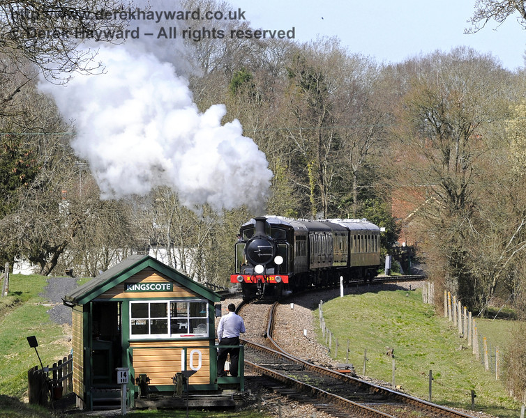 B473 leaves Kingscote as the signalman waits with the southbound single line token.  25.03.2012  7714