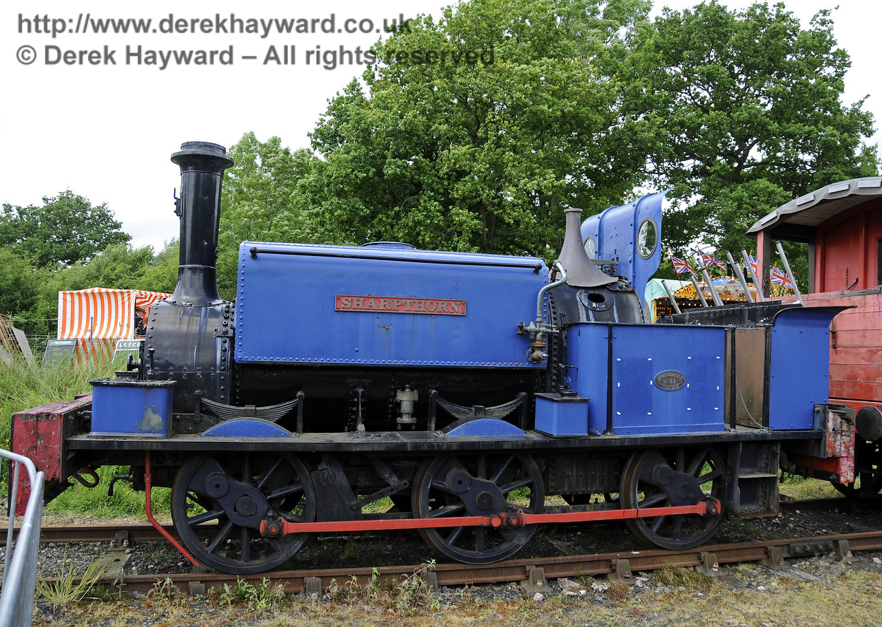 Sharpthorn was cosmetically restored to a high standard for the Bluebell 125 celebrations in 2007, but unfortunately since then it has been left to deteriorate at Horsted Keynes.  It is now in a sad condition and is seen in the Up Yard on 22.06.2013.  8976