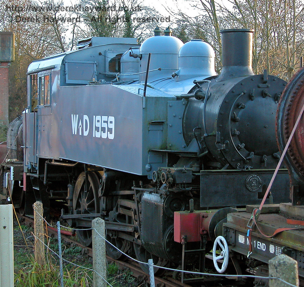 SR USA class Dock Tank No.WD 1959, stored in a back siding at Sheffield Park. 03.12.2006
