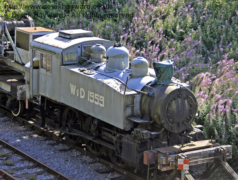SR USA class Dock Tank No.WD 1959, now stored in the northern headshunt of the Up Yard at Horsted Keynes, near Leamland Bridge.  There appears to be no strategy to conserve or maintain this engine, and it is deteriorating in the open.  03.08.2014  11440