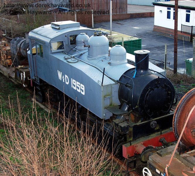 SR USA class Dock Tank No.WD 1959, stored in a back siding in wartime grey livery. Sheffield Park 14.01.2007