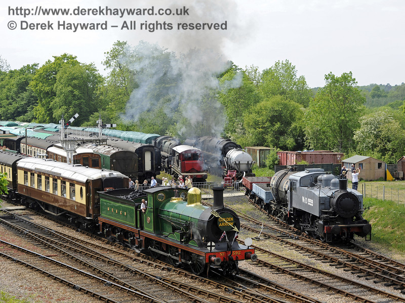SR USA class Dock Tank No.WD 1959 posed at Horsted Keynes during a Southern at War event, as 592 departs with a private Pullman charter.  07.05.2011  1207