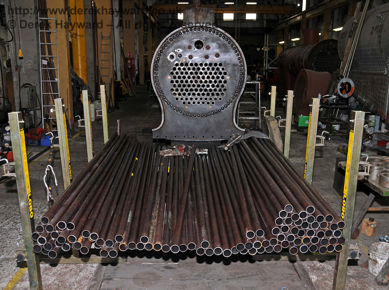 Boiler tube anyone? This lot has to go into the boiler for 178 and it can be seen that tubes in the lowest section of the tube plate have already been inserted. Sheffield Park Workshops 01.01.2010