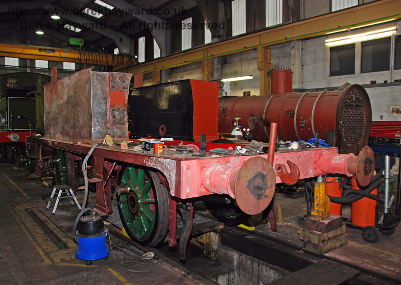 The frames from 178 were over the wheel drop, with two sets of wheels replaced. The boiler has been trial fitted and subsequently removed again. New paint can be seen inside the frames and on the side tanks. Sheffield Park Workshops 13.12.2009