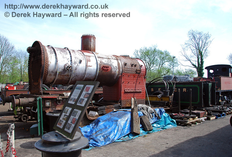 The boiler from H class 263 outside the works at Sheffield Park, with other parts of the dismantled engine behind. 23.04.2009