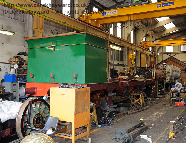 The rear offside of 263.  In the distance are the boiler for the engine, and beyond that the much larger boiler for 847. Sheffield Park Workshops 24.06.2010  2805