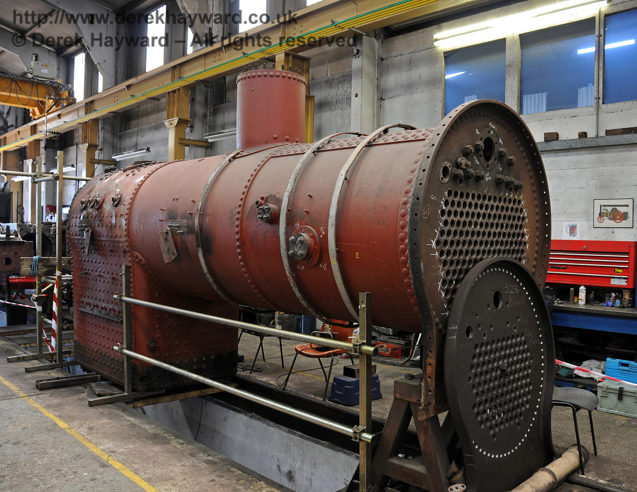 The boiler from 263.  The small tubeplate leaning against the front is from 323 Bluebell. Sheffield Park Workshops 23.05.2010  2639