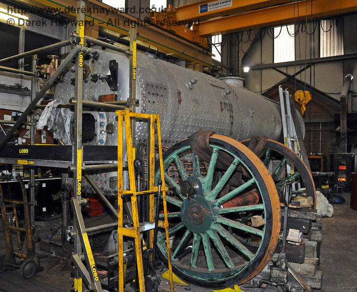 The wheels from 263 formerly in the eastern road of the workshops have been moved to a new position next to the boiler from 847.  This allows locomotive moves in and out of the eastern road. Sheffield Park Workshops 13.02.2010  474