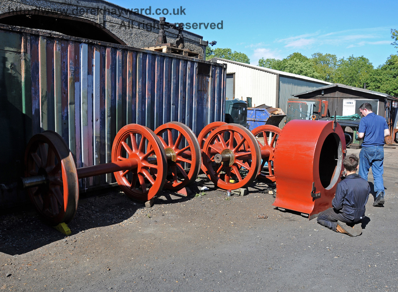 Painting the smoke box of 323 Bluebell. The wheel sets in the background are recently acquired spare wheels, that are in excellent condition. Sheffield Park Workshops 18.07.2010  3179