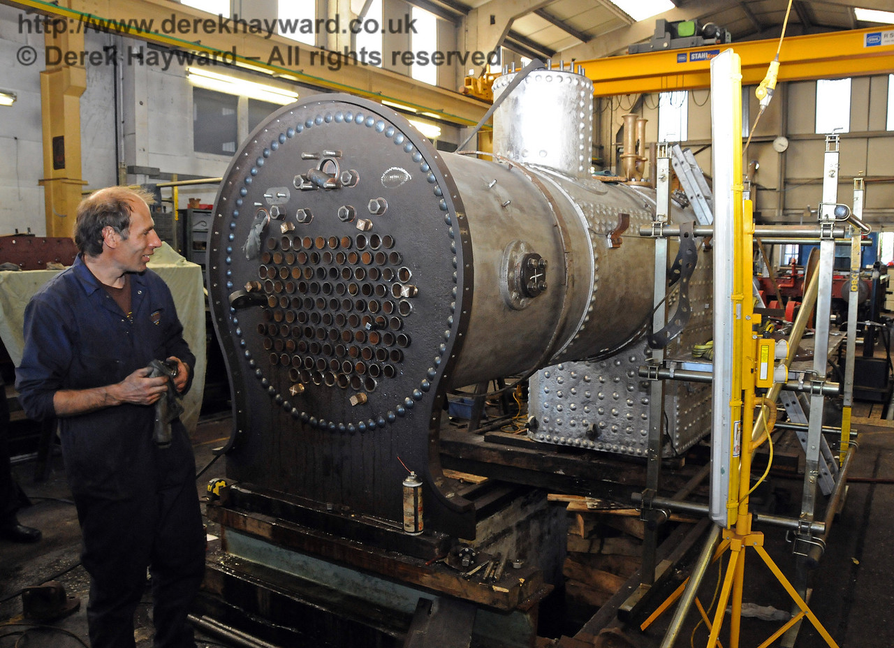 Chris Shepherd working on the boiler tubes of 323 Bluebell. Sheffield Park Workshops 18.07.2010  3173