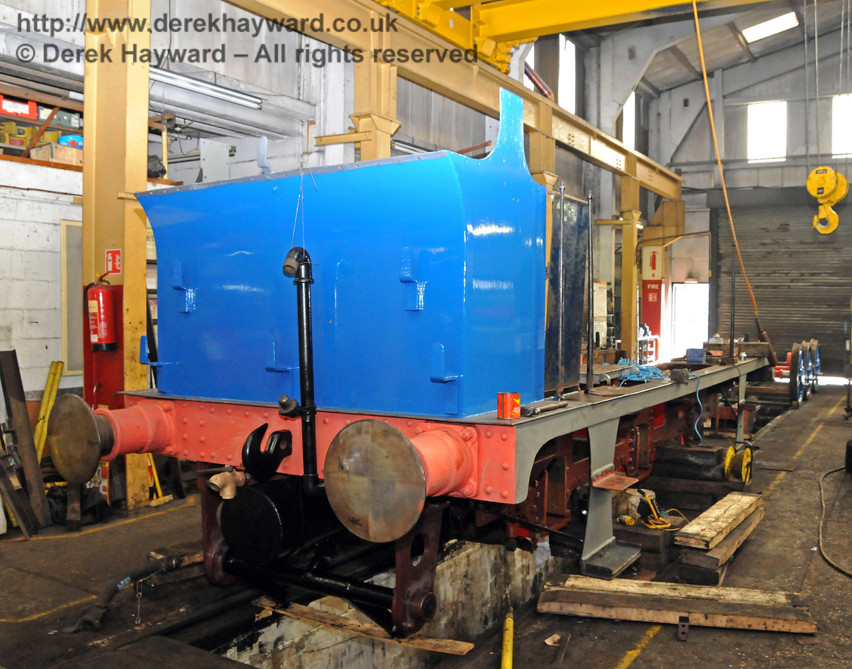 The rear offside of 323. In the background the wheels are adjacent to the main door. Sheffield Park Workshops 26.03.2010   1613
