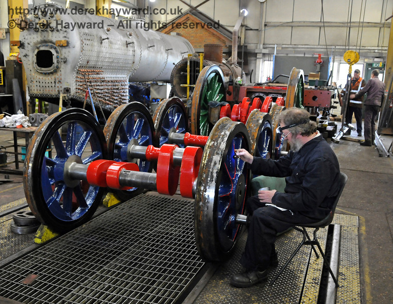 Lewis Nodes busy lining out the wheels for 323 Bluebell. Sheffield Park Workshops 08.05.2010  2345