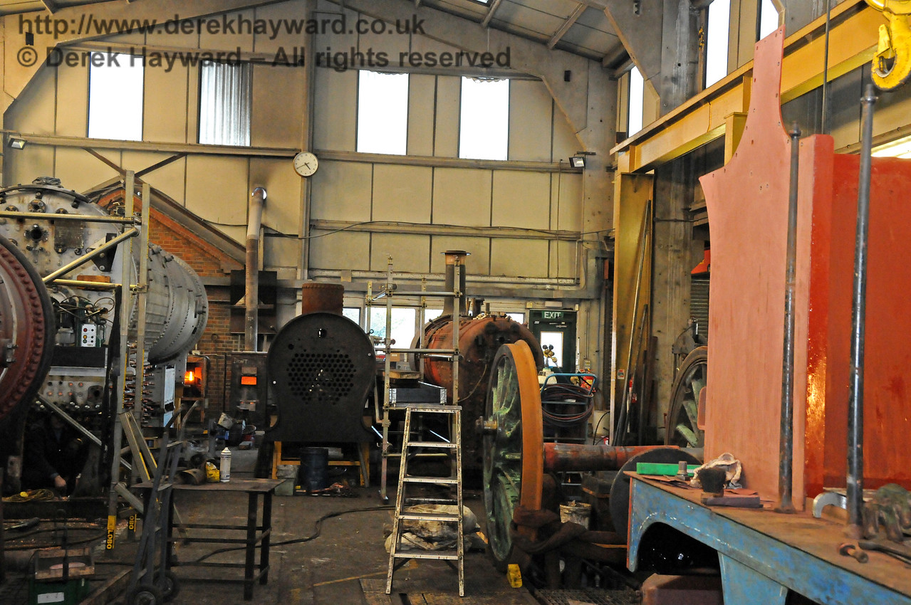 Looking down Sheffield Park Workshops the boiler from 847 is on the left, the boiler from 323 Bluebell in the centre, and the boiler from 55 Stepney on the right. The large set of driving wheels on the right are from 263, and await painting. 06.03.2010. 1152