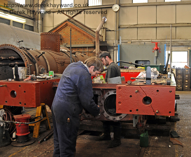 The frames from 323 have been repositioned to the rear of the workshops and the new cylinders were being fitted. Sheffield Park Workshops 28.04.2010  2082