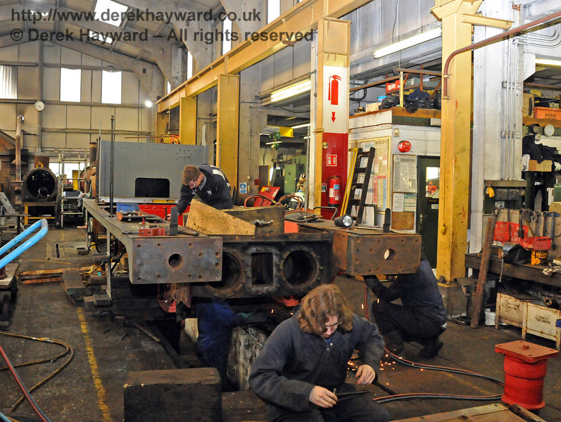 As usual in recent times a significant number of people were working on the engine (some out of shot in the pit). Sheffield Park Workshops 21.03.2010  1517