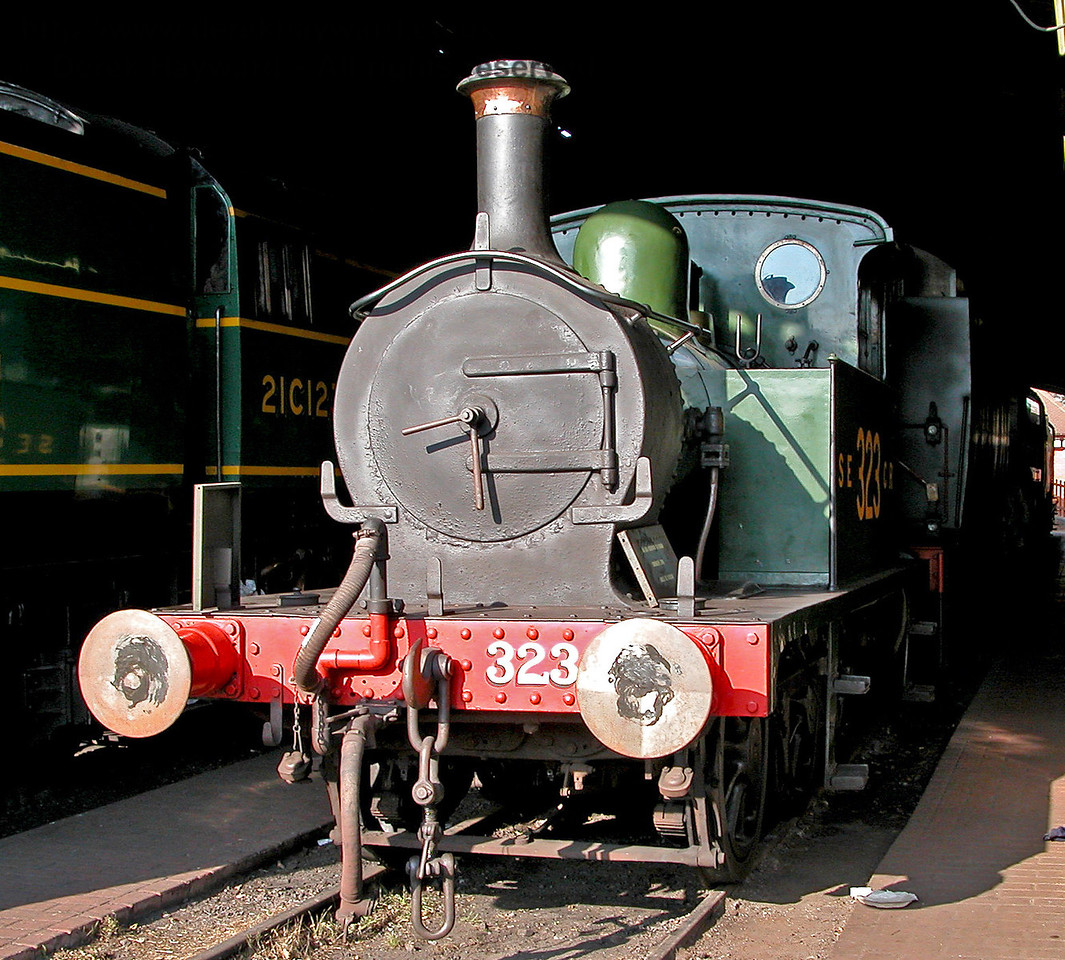 Before overhaul SECR Wainwright P-class tank 323 is seen in Sheffield Park Shed on 28.10.2003