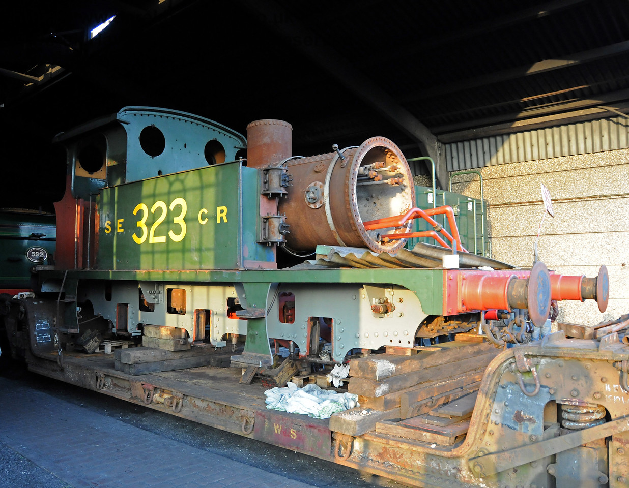 323 has been moved into Sheffield Park Shed. Some new paintwork can be seen on the lower part of the frame. 06.02.2010  371