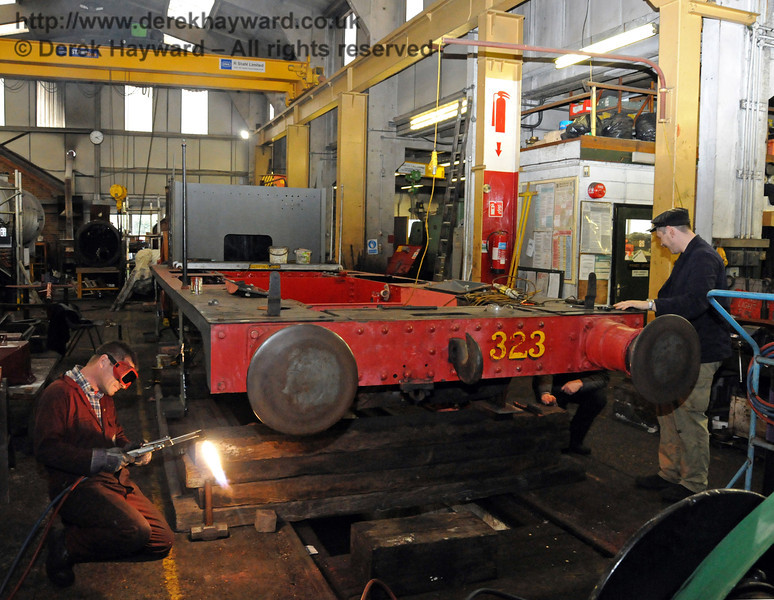The front buffer beam of 323 Bluebell was being removed to allow the cylinders to be replaced. Sheffield Park Workshops 13.03.2010  1394