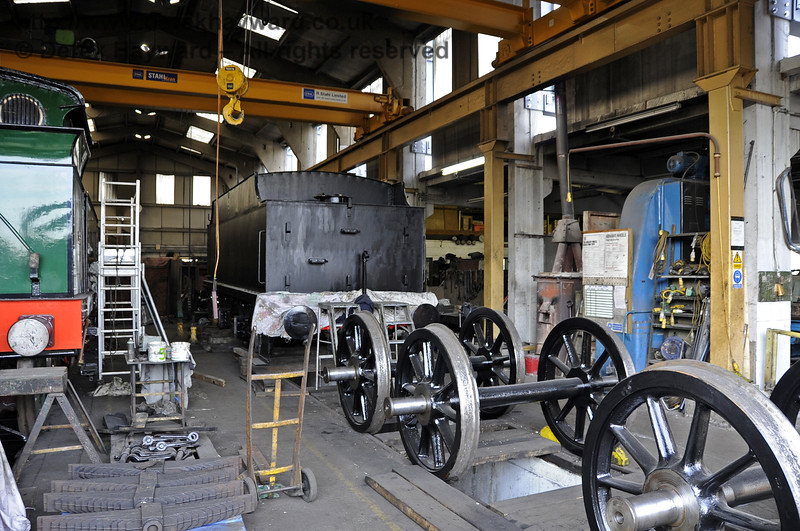 The tender from 541 and it's wheels inside Sheffield Park Workshops.  16.04.2012  4372