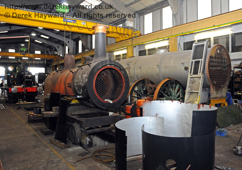 A general view of Sheffield Park Workshops on 20.02.2010. The boiler and smokebox from Stepney is in the foreground. On the right is a set of driving wheels from 263, and the boiler from 847. In the background is 178, which has since entered service, making way for 323 Bluebell.  645