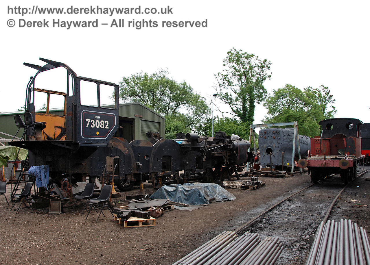 The frames from 73082 Camelot, with the boiler behind.  On the right is 178. Nearest the camera are replacement boiler tubes, which have since been installed in the boiler from B473. Sheffield Park Shed 17.06.2009