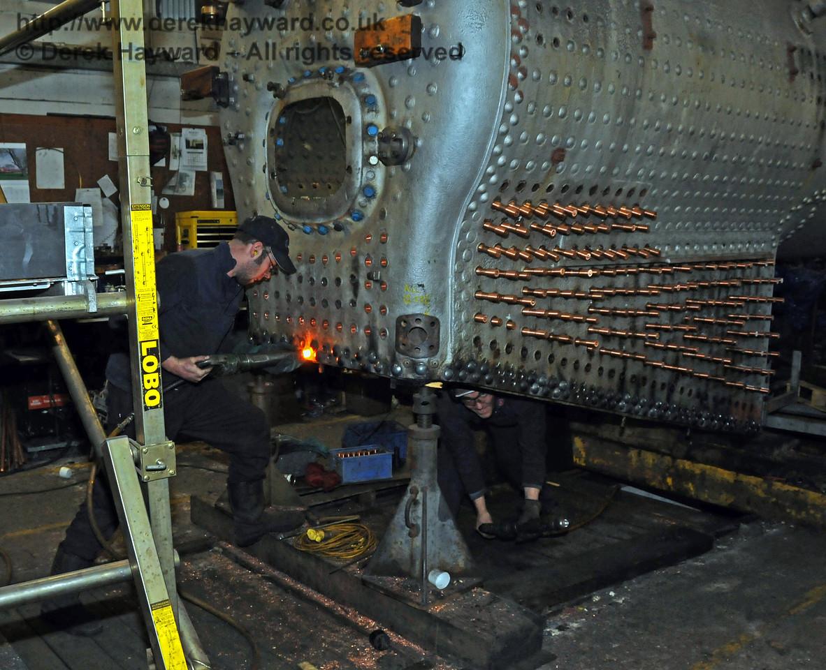 Hammering the hot rivet into shape. Sheffield Park Workshops 06.03.2010  1139