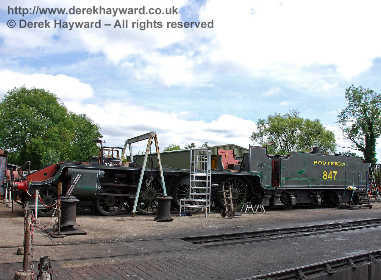 A shot of 847, with some repairs and painting on the tender evident. Sheffield Park Shed. 16.08.2009