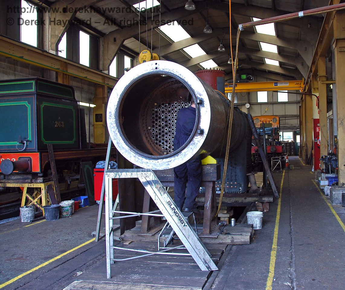 A wider view of the workshops, with B473's boiler in the foreground, the frames behind the boiler (on the same road) and the H class frames on the left. Sheffield Park Workshops 27.06.2009