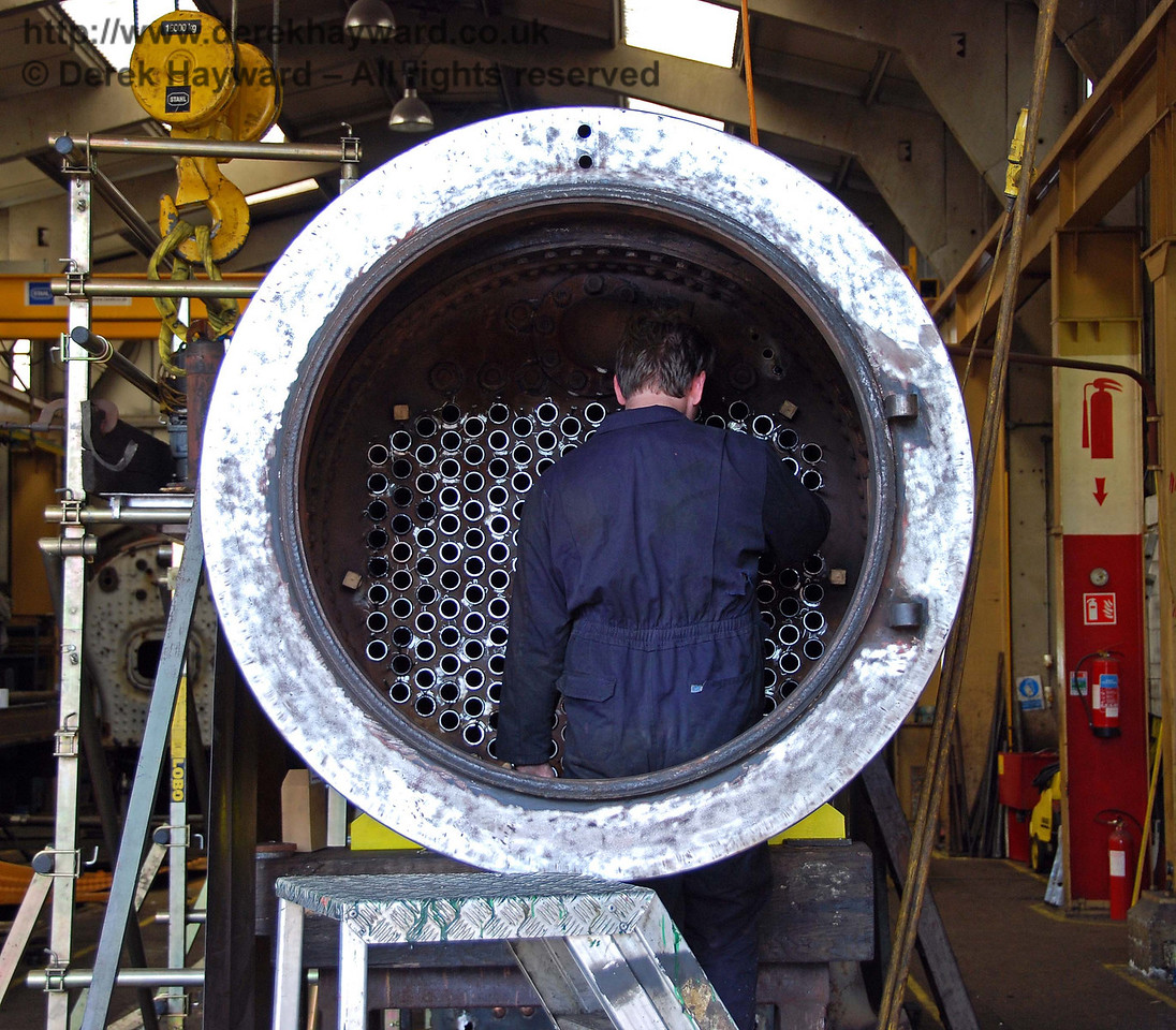 A gentleman was busy, working on the new tubes in B473's boiler. Sheffield Park Workshops 27.06.2009