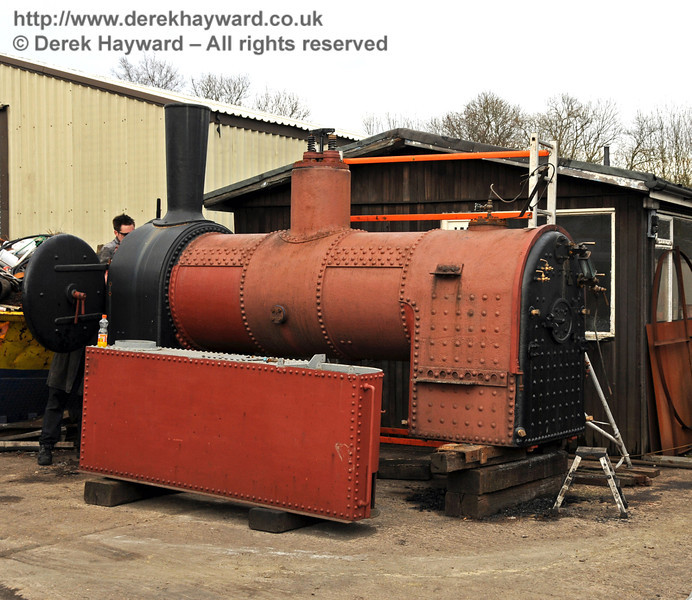 Baxter has passed a hydraulic test, and is seen here with work in progress at Sheffield Park Workshops on 20.02.2010. A side tank is in the foreground. A steam test will follow in due course.  664